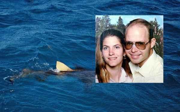 семейная пара и акула